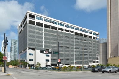 Custom perforated metal and screen facade for the Courthouse Center Parking Garage.