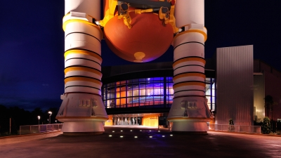 Night photograph of the Kennedy Space Center Visitor's complex.