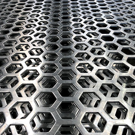 Photo of perforated metal moire patterns.