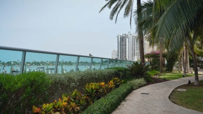 Tilted glass security railing for Flamingo Bay.
