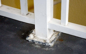 Plate-mounted railings bring unwanted moisture into the concrete below.