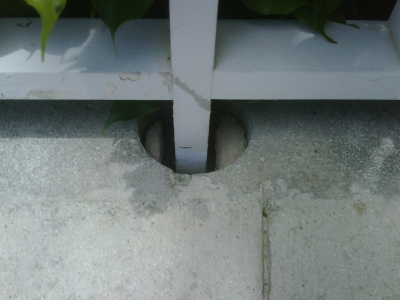 Example of a post socket, a poor system for protecting the concrete.