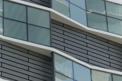 Detail of custom aluminum painted facade panels by Poma.