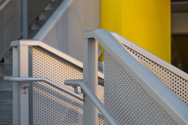 Detail of the perforated metal stair at Park-Line Palm Beaches.