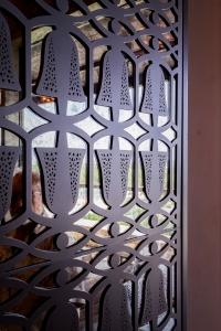 Detail of custom perforated metal dancer motif at Gran Destino